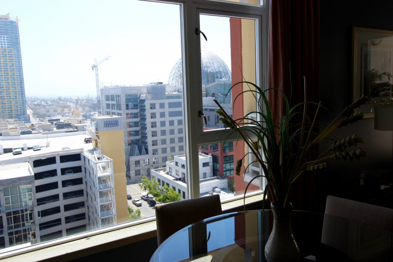 Living room with glass table and view of the city at Diamond Terrace in Downtown San Diego CA
