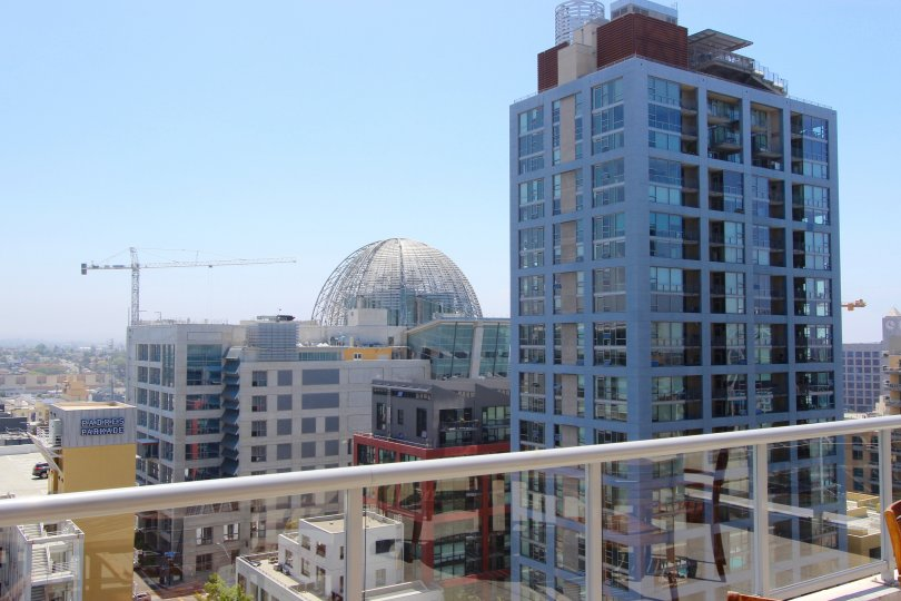 A few buildings, a dome and a construction crane in the distance, Diamond Terrace neighborhood