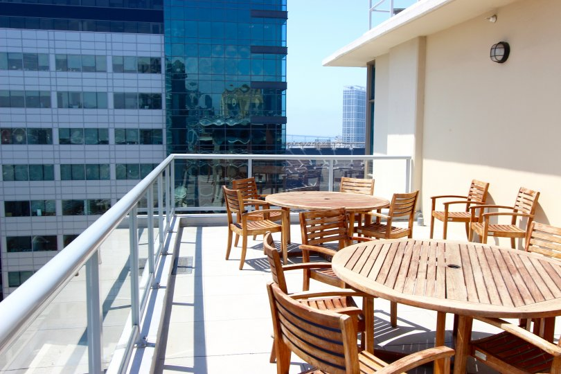 A porch with tables in Diamond Terrace in Downtown San Diego CA.