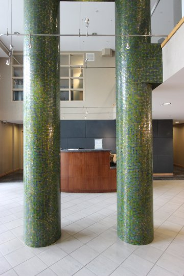 Green Mosaic Columns in the Foyer of a building in Discovery
