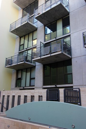 A sunny day in the DOMA with residential building with glass window.