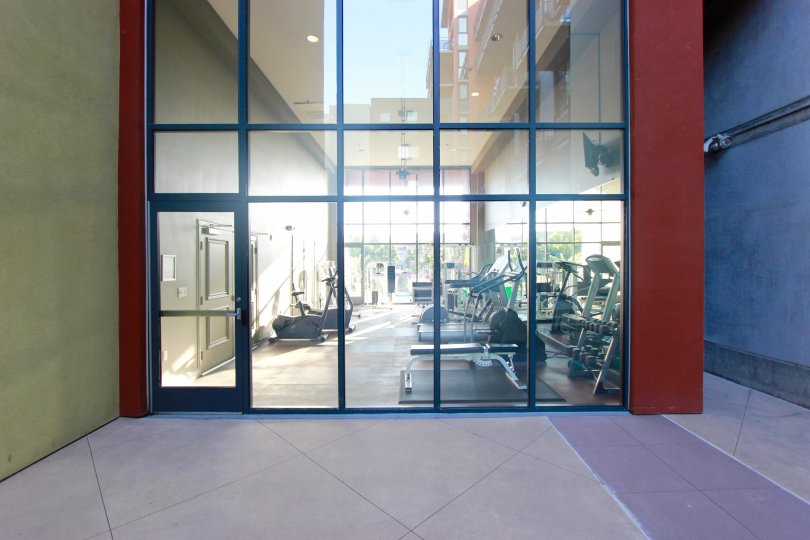 Glass wall & doorway leading to a fitness center at DOMA in Downtown San Diego CA