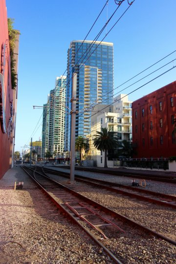 Train track in DOMA, Downtown San Diego, California with a city view on a sunny day