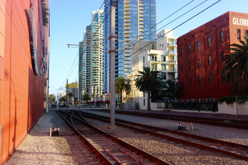 A shady railroad and buildings in downtown San Diego