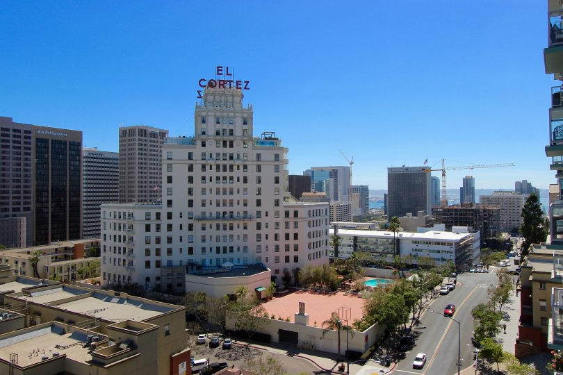 The large facade of the El Cortez hotel looms around its neat gardens and wide streets in downtown San Diego, CA
