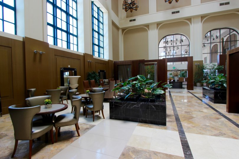 Large room with marble floors filled with furniture inside Electra at Downtown San Diego CA