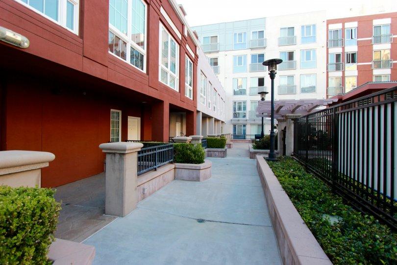 sunny day apartments nice neighborhood, lighted and fenced. many windows.