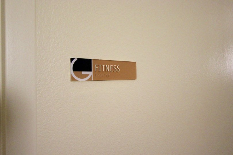 A sign on the wall identifying the Fitness room in Gaslamp City Square in downtown San Diego, CA