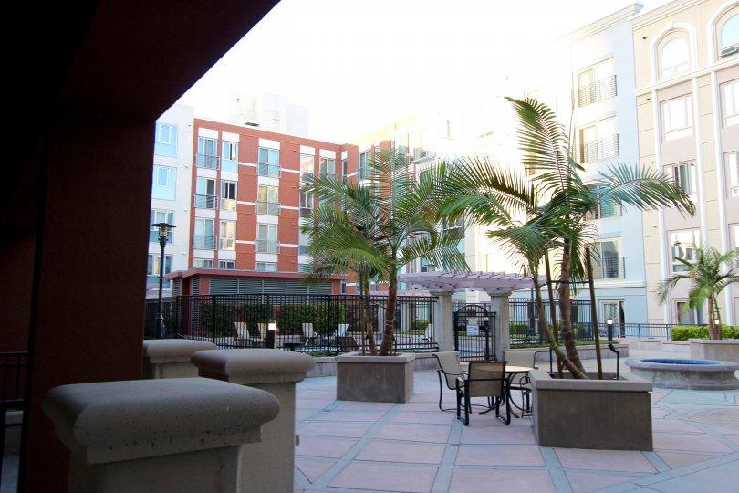 This hotel looks beautiful nearly lot of apartments are there and chairs are there and the coconut trees also there in Gaslamp City Square