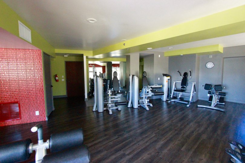 Gymnasium with equipment and wooden flooring in Harbor Club. .