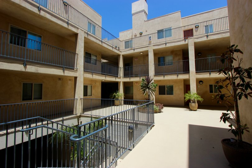 A sunny day in the area of Hawthorn Place, outside, courtyard, balconies, potted plants, stairs