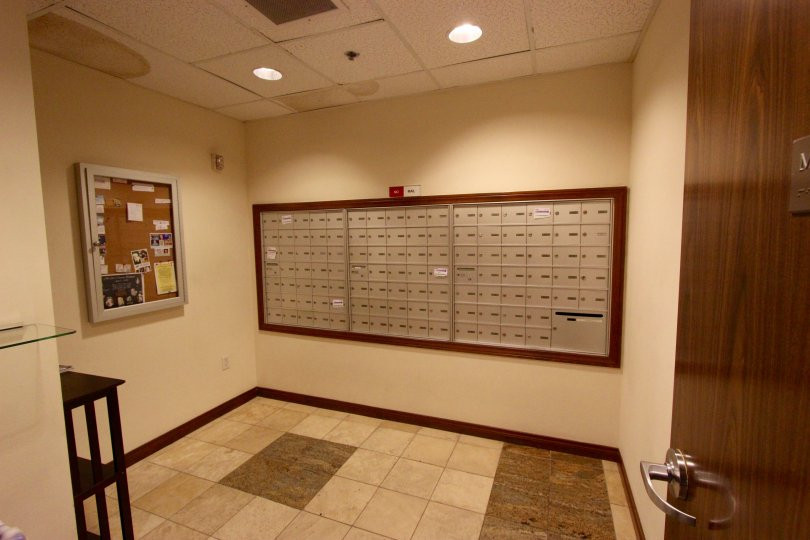 Subdued and simple interior view of the Horizons with mailboxes and noticeboards with muted colors and well-lit clean interiors