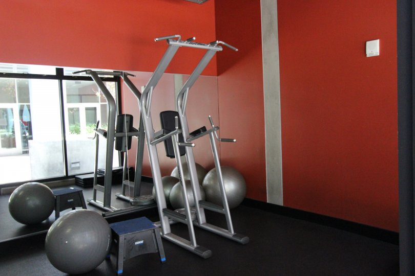 Icon exercise equipment with mirror and red walls downtown San Diego California