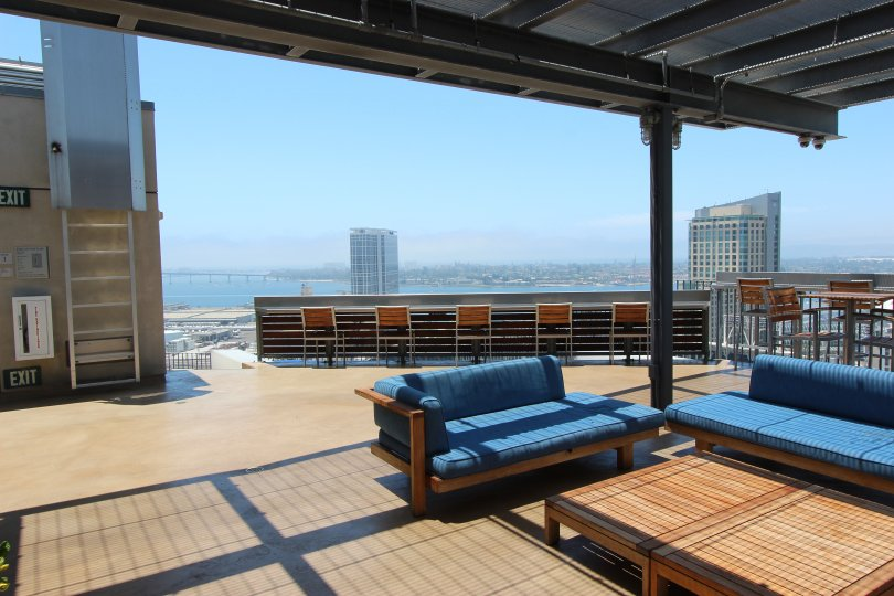 A well lit patio on the roof top of Icon with a view of the city in Downtown SD CA