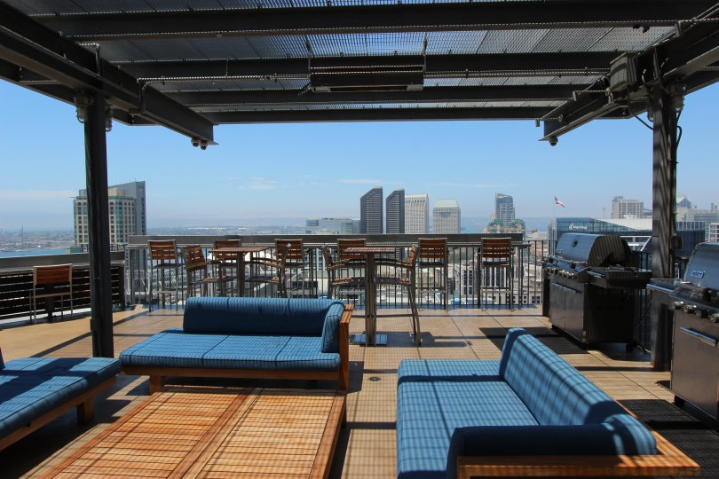 A breath taking view of the city skyline from the roof top patio equipped with grills and outdoor furnishings