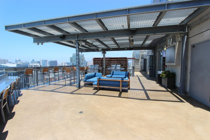 A sunny day in the area of Ico, outside, patio, covered, chairs, tables, couches, door