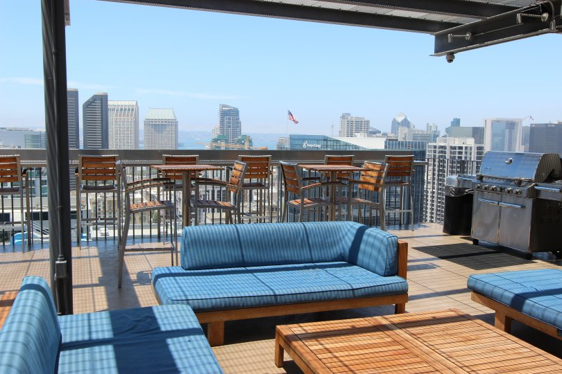 The View of the Hotel in Icon shows the city Downtown San Diego has sofa and dinning tables