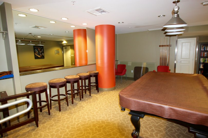 Large orange cylinder next to bar stools and a pool table at La Vita in Downtown San Diego CA