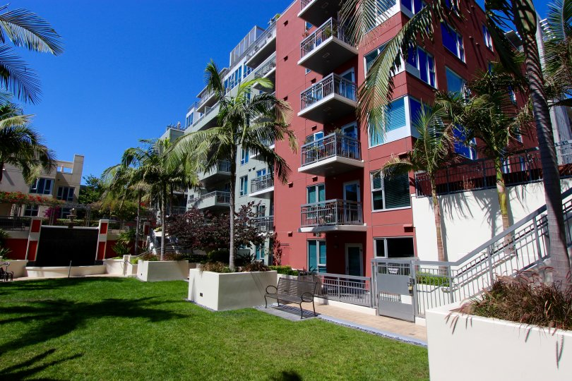 Palm trees set the scene by this beautiful apartment building in San Diego, California