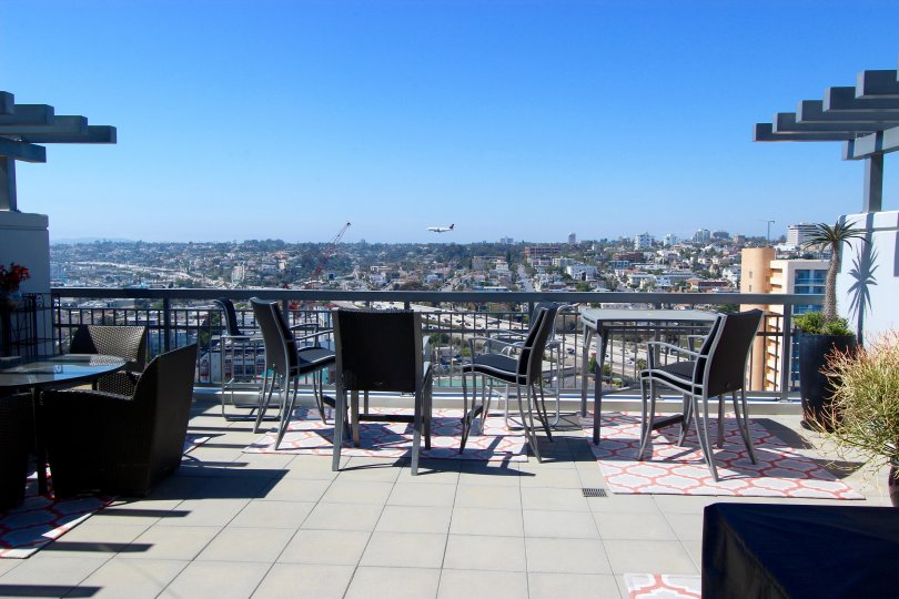 Patio chairs are arranged to look out over the cityscape at LaVita
