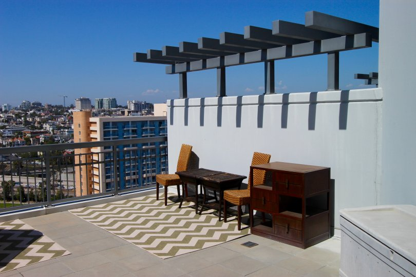 A terrace overlooking the city, some furniture in La Vita neighborhood