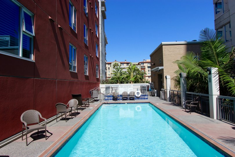 A small pool sits next to a red building at La Vita condos.
