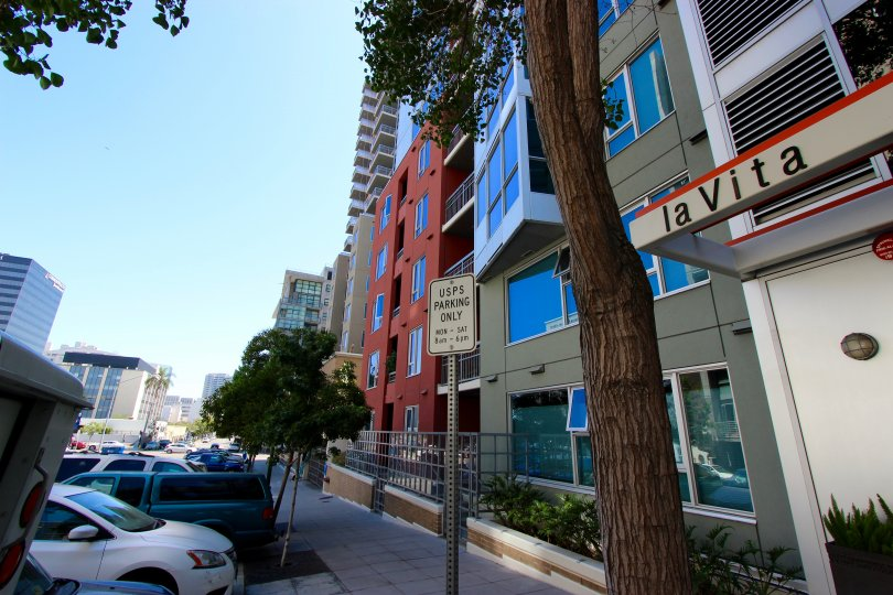 La Vita, City: Downtown San Diego, a road and cars parked, there are buildings and trees