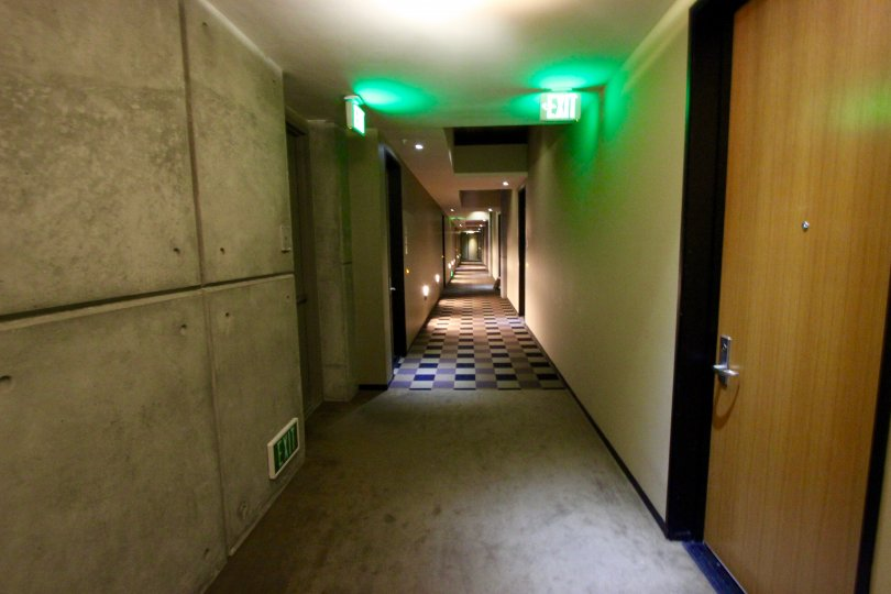 THE HOTEL IN THE M2I WITH ROOMS, AND EXIT WAY, WOODEN DOOR.