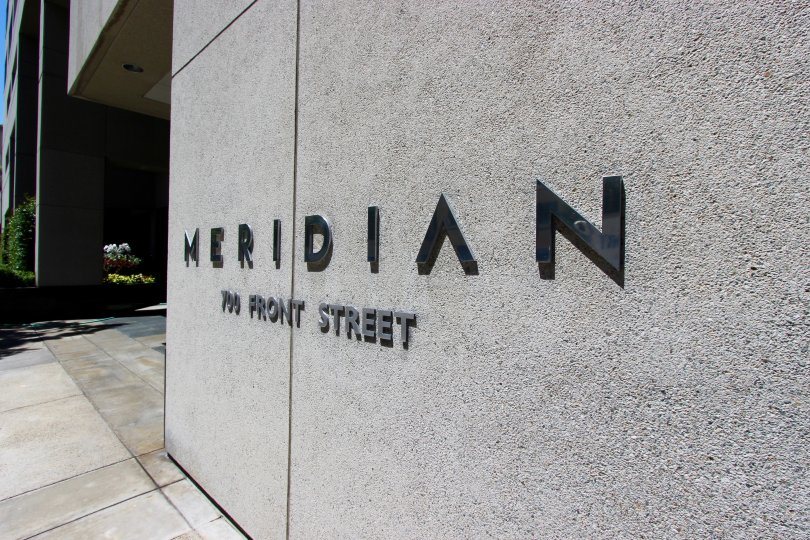 Back sign on a gray residential building at Meridian in Downtown San Diego CA
