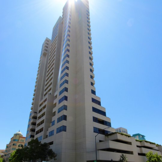 A high rise building with sun shining i the community of Meridian