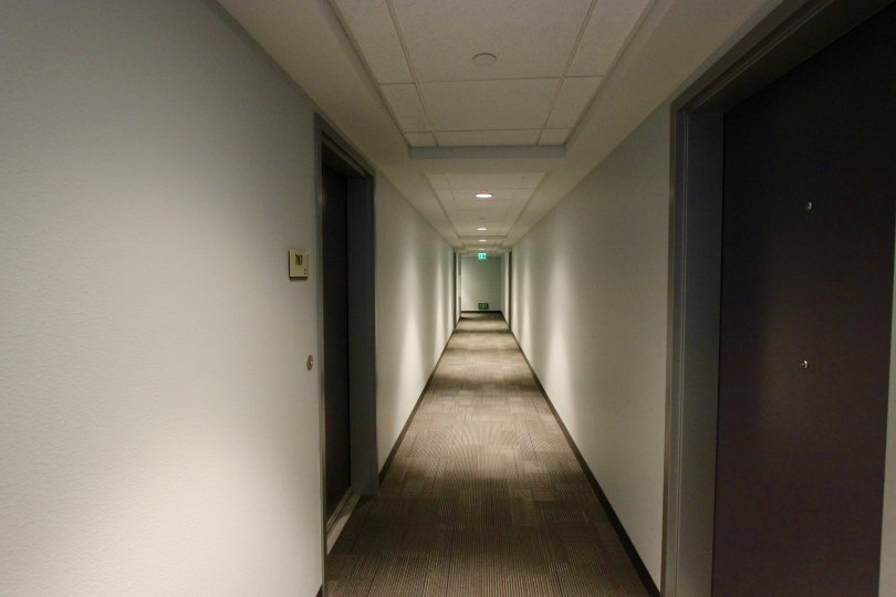 This is the warranda of the hotel which have a lot of rooms, light lamps and switches in the community of Nexus