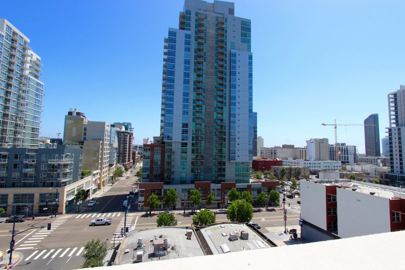 Elevated city shot of the Nexus community in Downtown San Diego, CA focusing on a high rise building.