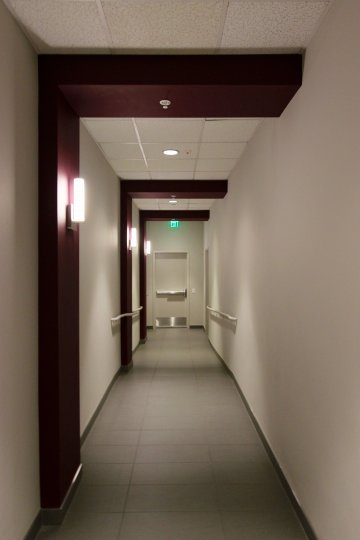 Inner view of a building with nice ceiling and exit door in Nexus.