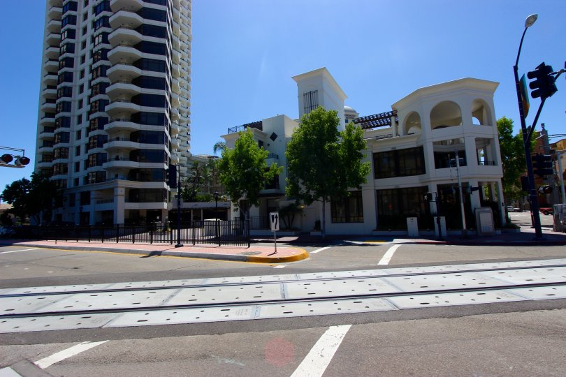 Pedestrian crossing with adjacent railway crossing and wide roadway next to Park Place in Downtown San Diego, CA.