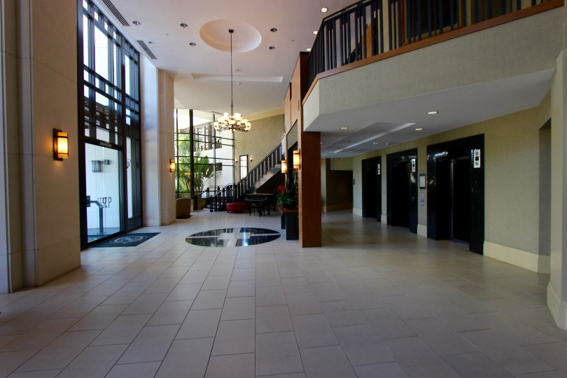 The lobby in the Park Place community with tiled floor and stairway