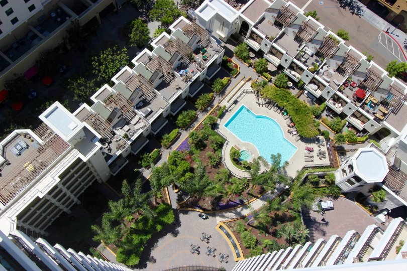 An aerial view is shown over a Park Place community pool.