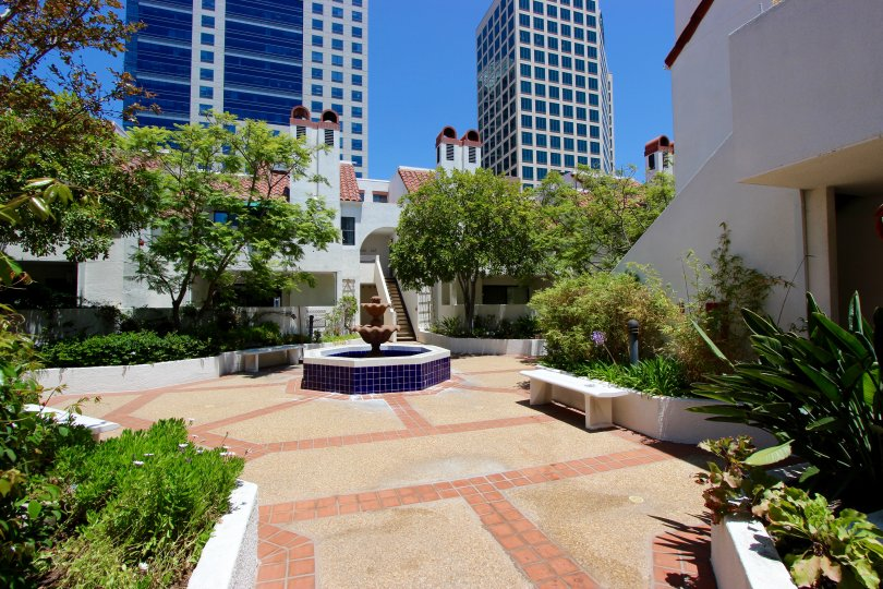 A fountain surrounded by trees in a plaza at Park Row in downtown San Diego, CA