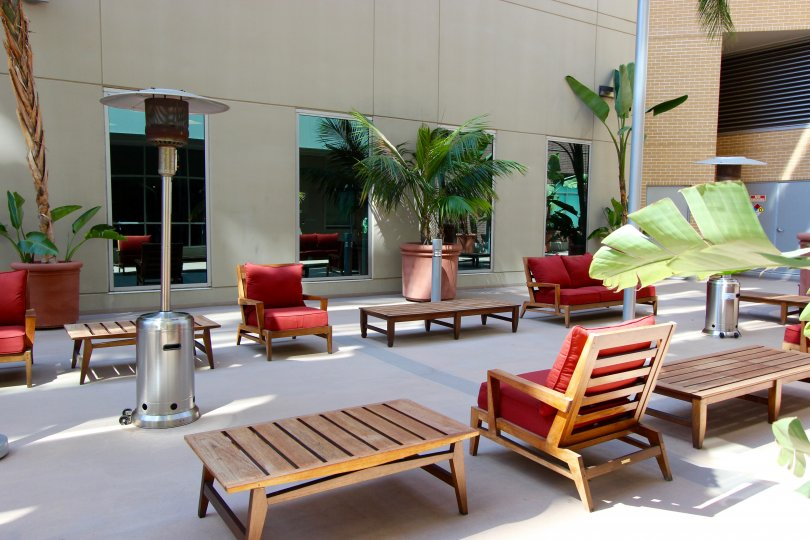 Patio furniture outside of glass windows with a fire lamp at Park Terrace in Downtown San Diego CA