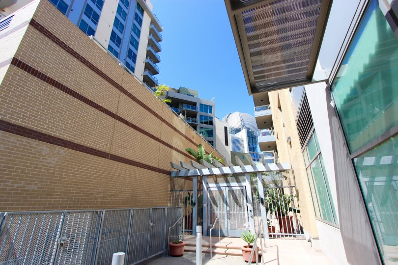 Gray railing mounted to a building next to glass at Park Terrace in Downtown San Diego CA