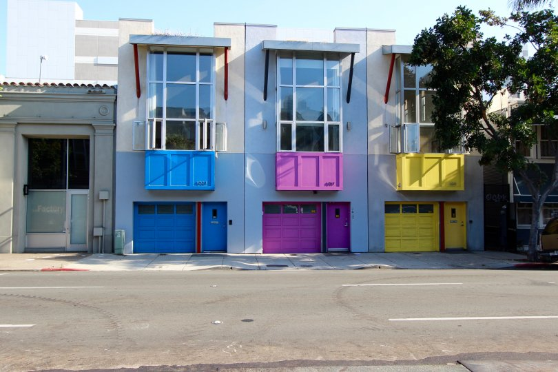 Purple, yellow and blue garage doors at Rowhomes on F in downtown San Diego CA