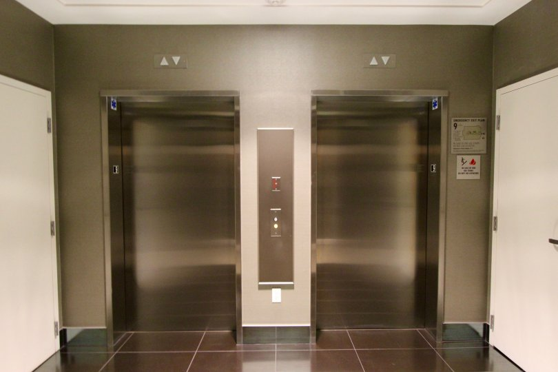 Dual stainless steel elevators in the lobby of Sapphire Tower in downtown San Diego, CA