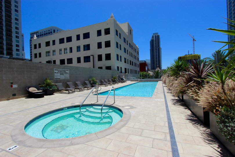 view of sapphire tower with a clear sky and swimming pool in san diego