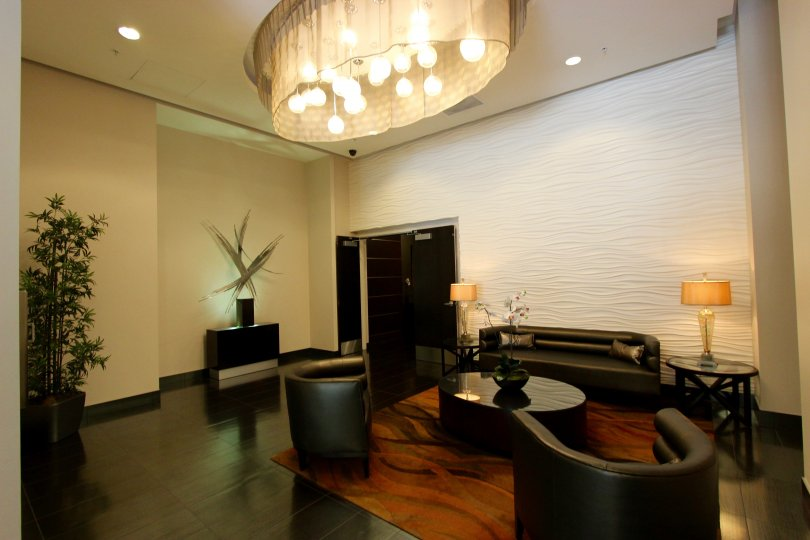 Warm and radiant interiors with calming ambiance, gorgeous chandelier and luxurious furniture at the Saphire Tower