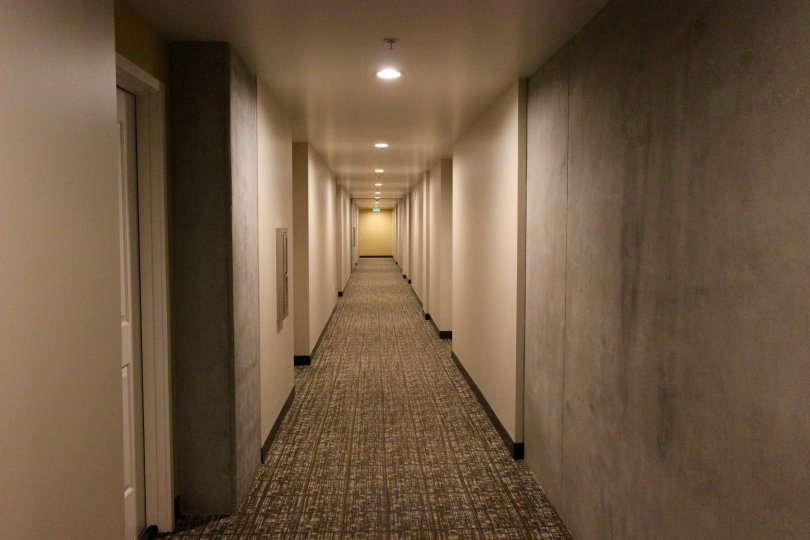 Hallway with recessed lighting and carpet in the Smart Corner community
