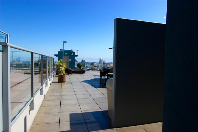 A sunny day in the area of Smart Corner, outside, potted plants. rooftop, skyline