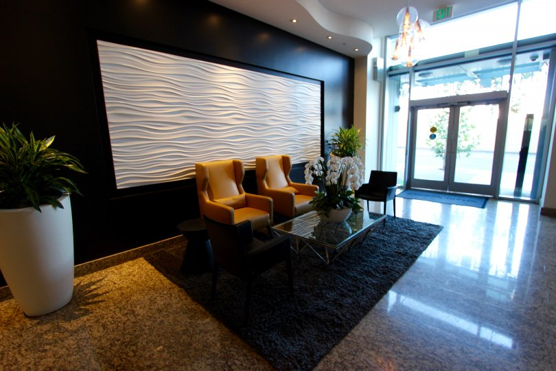A wavy white piece of art sits on the wall in the lobby of the Smart Corner condos.