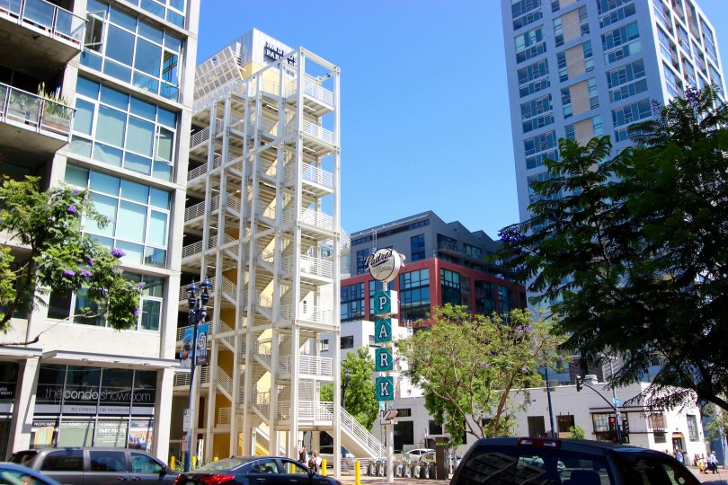 a view of Smart Corner showing the exterior of downtown buildings and a parking lot.