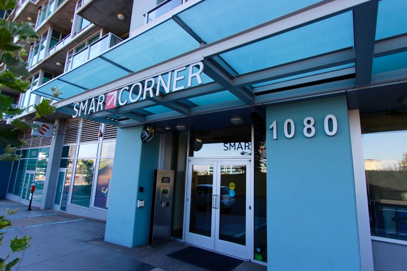 Large Blue leasing office with huge windows for Smart Corner