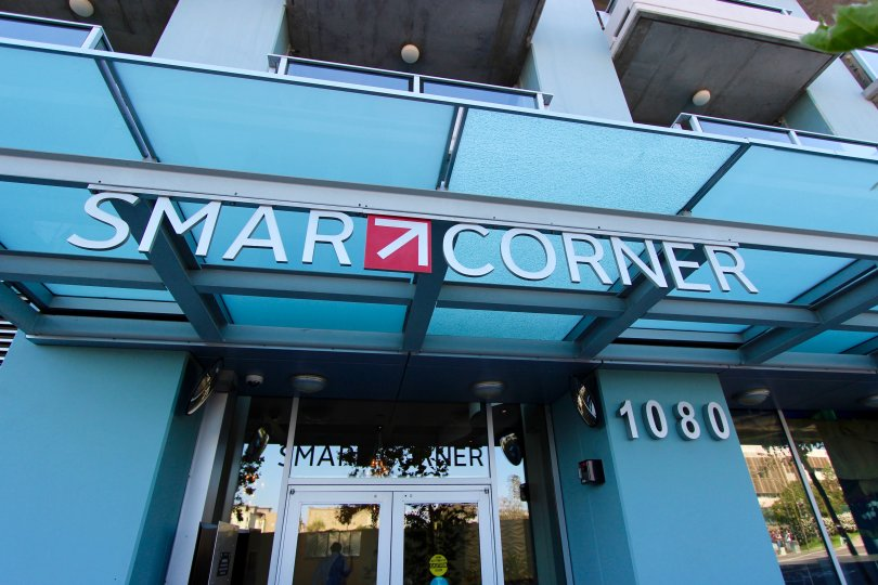 A sign entering a building that is showing the community Smart Corner