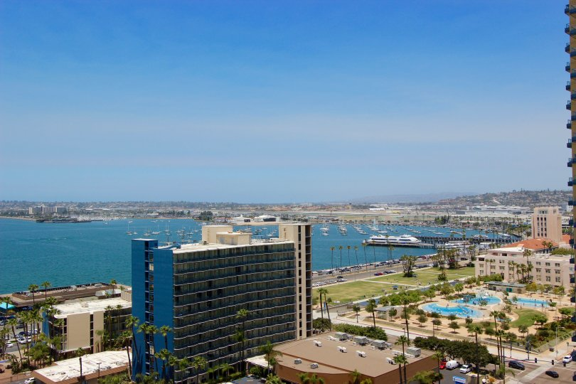 The Grande is San Diego, CA, overlooking the bay with a cruise ship.